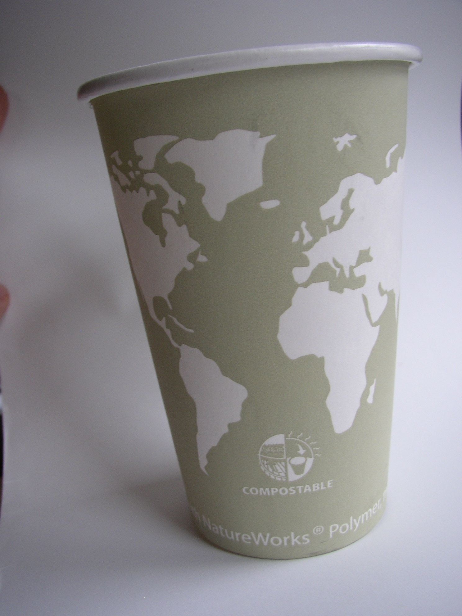 continents outlined on a coffee cup